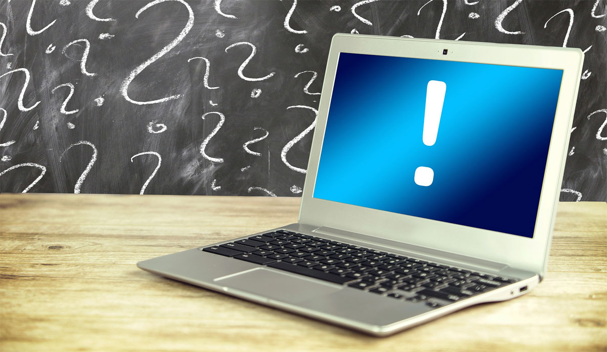 Laptop computer with error symbol